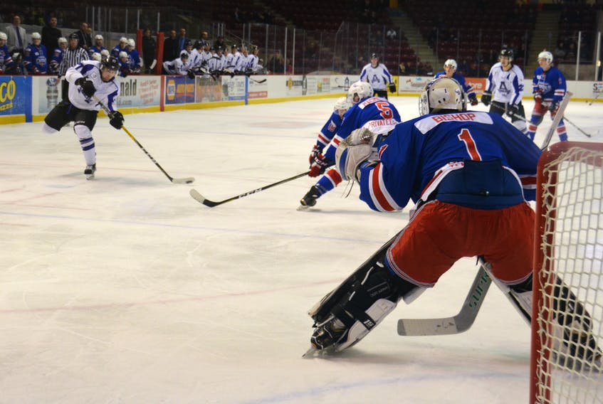 Amherst Ramblers left-winger Layton Parsons tests new Summerside Western Capitals goalie Alex Bishop during Monday's New Year's Day game in Summerside. The Capitals lost the game 4-3.