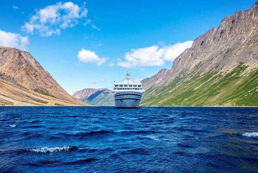 One Ocean Expeditions' ship the RCGS Resolute is shown sailing past the Torngat Mountains National Park, Newfoundland and Labrador.