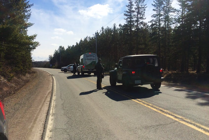 RCMP stopped vehicles on Portapique Beach Road on Sunday morning following a shooting in the area, while suspect Gabriel Wortman was still at large in a car resembling an RCMP vehicle. - Harry Sullivan/Saltwire Network