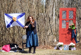 Musician Rhonda MacLellan, a friend of shooting victim Joanne Thomas and John Zahl, hosted a memorial in Portapique on Thursday for the couple in front of an old red door that stands on a property along Highway 2. The red door, located among a tall stand of lilacs, was a favourite sight for Joanne when the flowers were in full bloom.