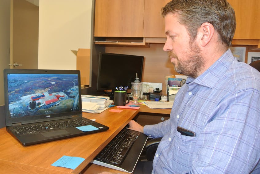 Jonathan McClelland, CEO of the Cumberland Business Connector, looks over a business recruitment/retention video that was produced to encourage employees to consider working in Cumberland County. The project features eight employees and is meant to inform potential workers of opportunities that are available and the skill sets required.