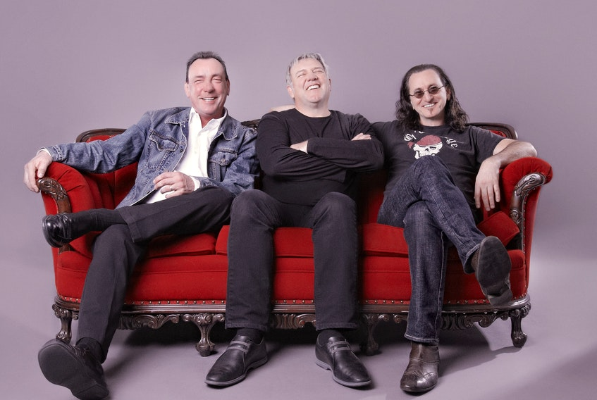 Rock fans nationwide are mourning the loss of Rush drummer Neil Peart (left), shown here with bandmates Alex Lifeson and Geddy Lee in a promotional photo for the Clockwork Angels tour that brought the band to Halifax for the last time in 2013. - Universal Music Canada
