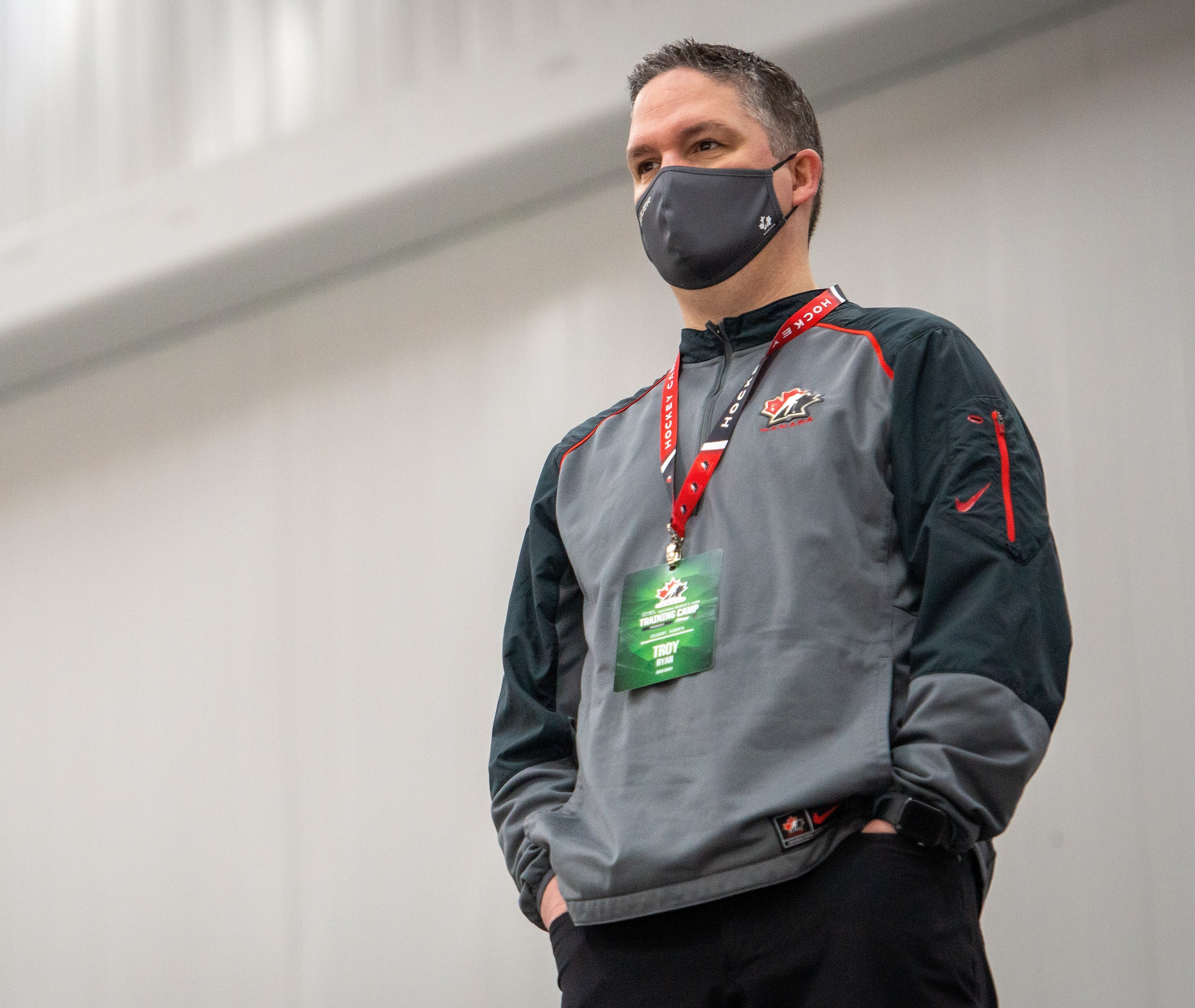 Head coach Troy Ryan of Spryfield watches practoce during a Hockey Canada's national women's team training camp at WinSport Arena in Calgary on January. - Hockey Canada