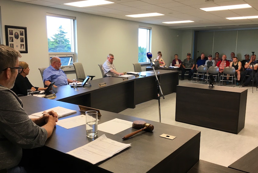 Coun. Keith Keating (third from left) addressed a group of citizens concerned about hiring for the construction phase of Grieg NL's salmon hatchery at the marine industrial park in Marystown on Tuesday, June 18.