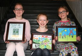 Three students from Sacred Heart Academy in Marystown had their artwork selected from submissions as part of the Town of Marystown's poster contest. Amanda Kavanagh (front) was selected as the first-place winner, while Maria Smith (left) and Lola Pittman were chosen as runner-ups.