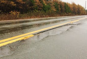 Rain fills a damaged section of the Burin Peninsula Highway between the Winterland branch and Marystown on Monday, Oct. 29, 2018.