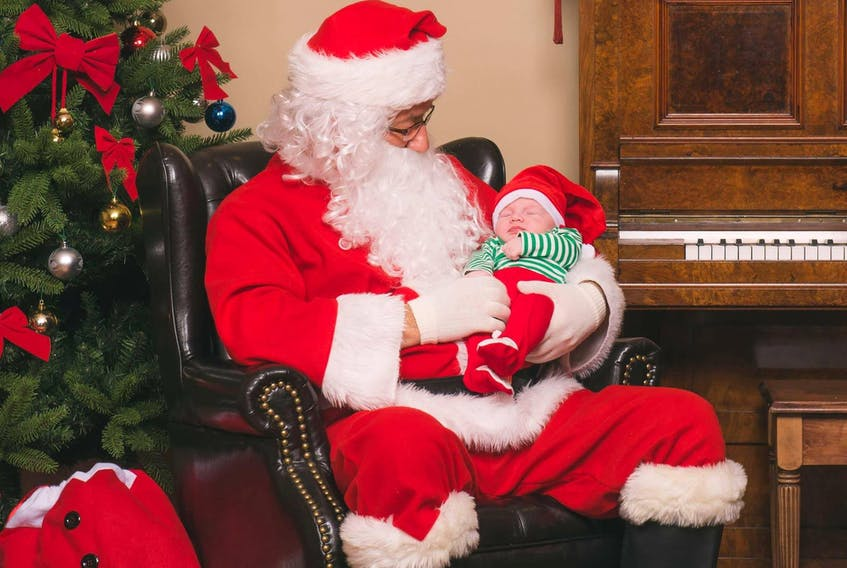 All was calm when two-month-old Oliver Keeping had his picture taken with Santa during a fundraiser by photographer Colin Pittman at St. Gabriel's Hall on Nov. 12. - Photo courtesy of Colin Pittman Photography