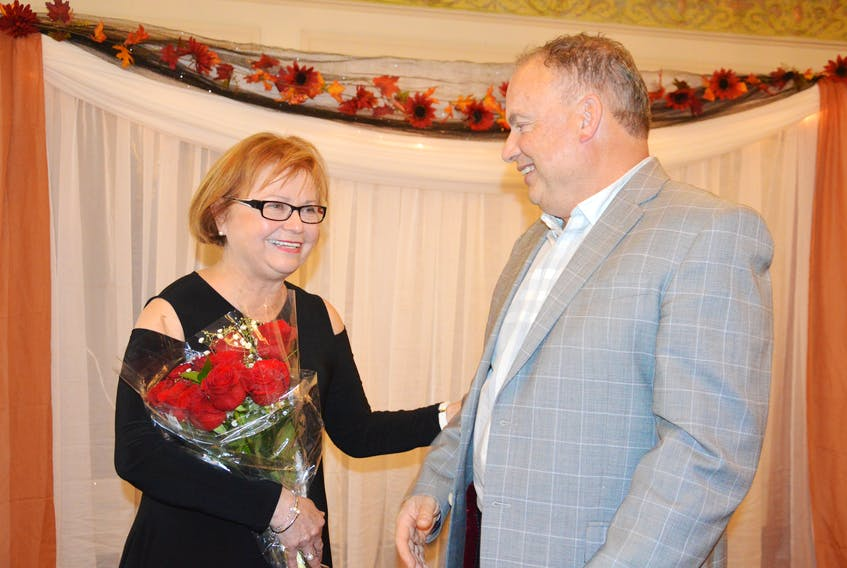 Retired MP Judy Foote spoke with St. Lawrence Mayor Paul Pike following the Burin Peninsula Chamber of Commerce's 6th Annual Business Awards held on Thursday. Foote, who was the keynote speaker for the event, received a painting and a bouquet of flowers from the chamber of commerce. Colin Farrell/ The Southern Gazette