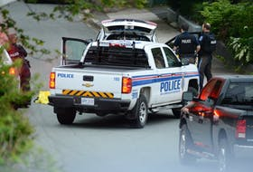 Police guard the scene of an apparent homicide on Craigmillar Ave. in St. John's early Sunday morning. The street has been closed to traffic and residents have been advised to shelter in place.