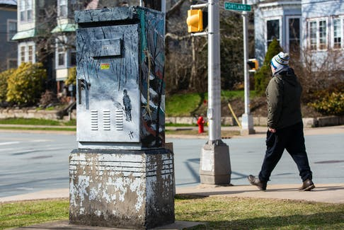 A traffic box at the corner of Portland and Pleasant streets, painted by artist Laura Legere.
