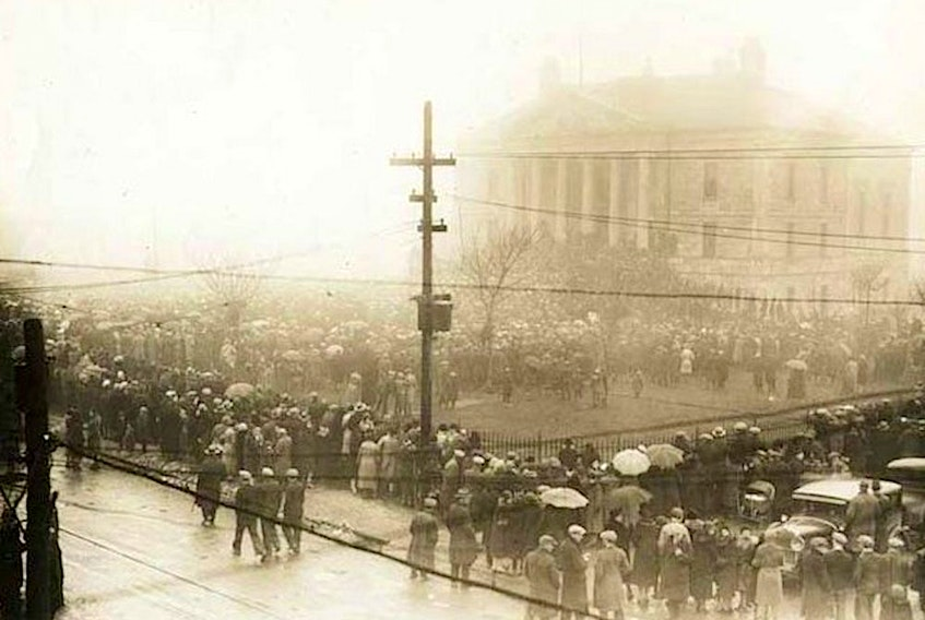 A crowd of nearly 10,000 gathered outside Newfoundland's then-national legislature, the Colonial Building in St. John's, on April 4, 1932, with many ensconced on the steps to the building. Eventually, many of the protesters forced their way inside, causing extensive damage and forcing occupants — including members of the police and politicians — to flee or bar themselves behind doors. — Provincial Archives