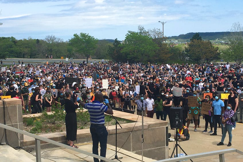 Dr. Paul Banahene Adjei, a Memorial University professor, speaks to the thousands of people who turned out Saturday afternoon at Confederation Building in St. John's for the Black Lives Matter NL rally.