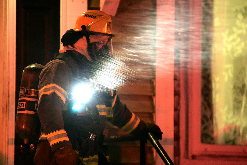 One woman was taken to hospital suffering from smoke inhalation after a house fire in the east end of St. John's Thursday night. Keith Gosse/The Telegram