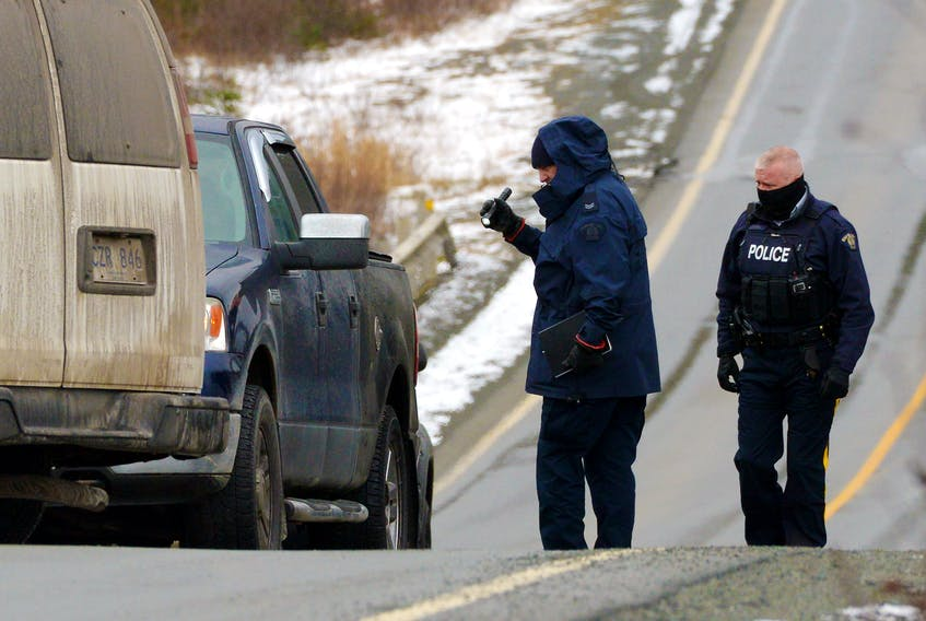 RCMP officers were examining a pickup on Route 10 on the southern shore highway Friday related to a suspicious death. Keith Gosse/The Telegram