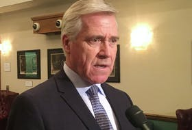 Premier Dwight Ball speaks to reporters Tuesday outside the House of Assembly.