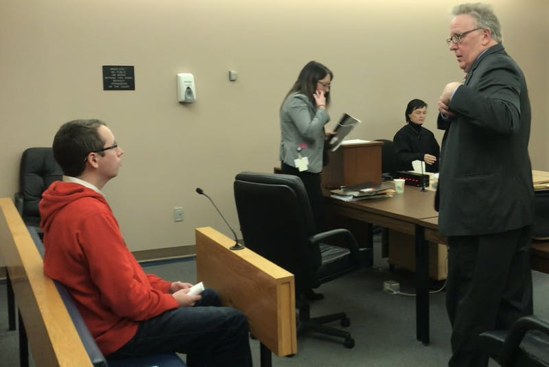 Kyle Brown speaks with his lawyer, Derek Hogan, following the conclusion of his trial in provincial court in St. John's. - Tara Bradbury