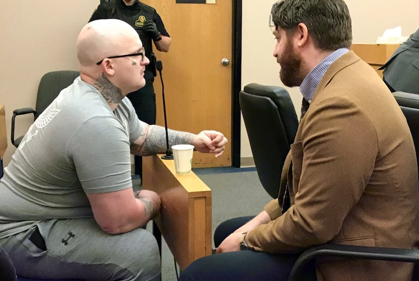 Tim Blake (left) speaks with his lawyer, Tim O'Brien, before his sentencing hearing in provincial court in St. John's Wednesday.