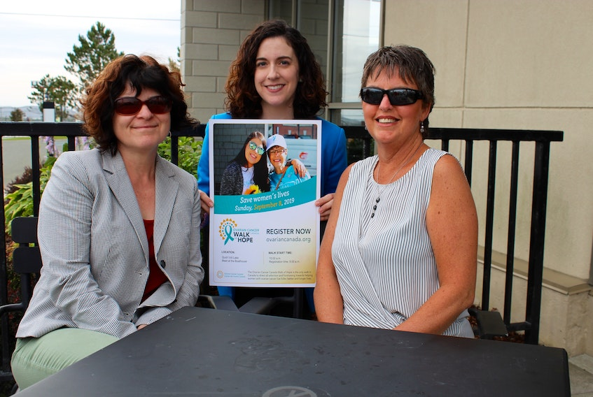 Finding a way to save women's lives is what the Ovarian Cancer Walk of Hope is all about. Christine Lawler-Shaw (right) is one of those survivors. She was joined on Tuesday to help support the walk set for Sept. 8 at Quidi Vidi Lake. On hand to help promote the walk are Marina Whitten, the walk's chair and a national board member of Ovarian Cancer Canada (left), and Virginia Middleton, a walk volunteer and communications co-ordinator.