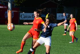 Jane Pope (left) of Holy Cross Avalon Ford moves the ball ahead of Suekiana Choucair of Edmonton Northwest United during their game on Wednesday, the opening day of the Toyota national senior men's and women's soccer championships in metro St. John's. The Alberta team defeated Holy Cross, the Newfoundland and Labrador champion, 3-1 at King George V Park. — Joe Gibbons/The Telegram