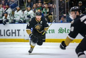 After James Melindy captained the Newfoundland Growlers to an ECHL title this spring, it was obvious the Growlers would want the hometown player back with the team for a second season. It took a little while, but the 25-year-old defenceman from Goulds eventually found that was what he wanted, too, leading him to sign a new contract with the team. — Newfoundland Growlers photo/Jeff Parsons