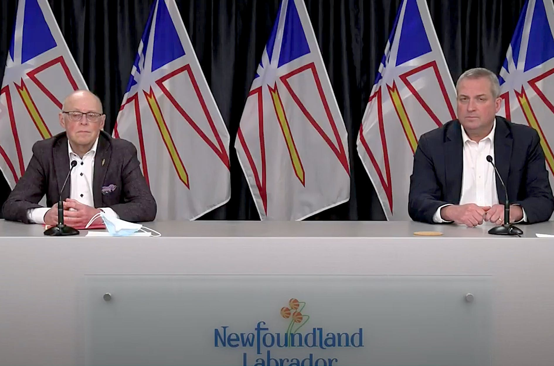 Provincial cabinet ministers John Haggie (left) and Gerry Byrne held a virtual media briefing Thursday to provide what they say is clarity to the issue of a PET scanner at the new hospital in Corner Brook. — YouTube/Screenshot
