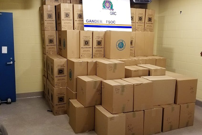 RCMP officers discovered 7,650 cartons of contraband tobacco and a quantity of Canadian currency in a cube van operated by a man from St. Philip's last Thursday near Gander. Charges have been laid. RCMP photo