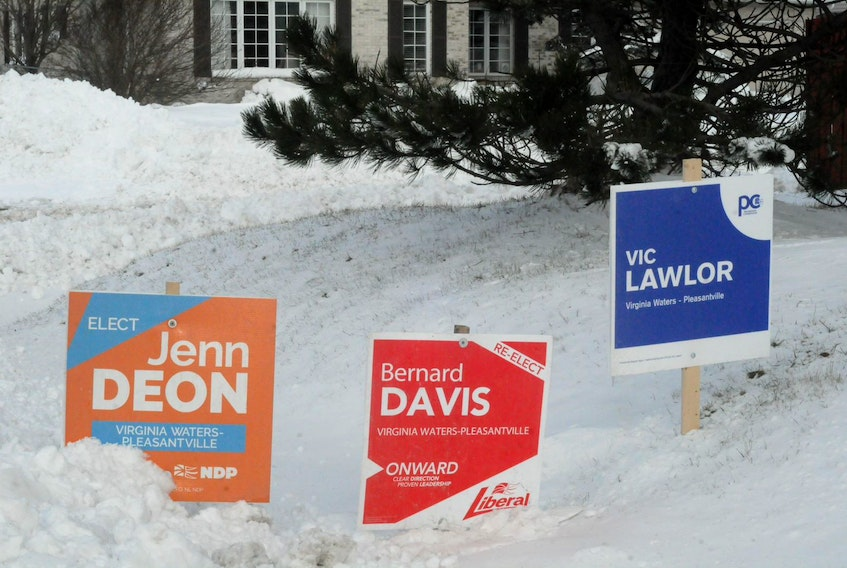 Election signs like these ones in the electoral district of Virginia Waters-Pleasantville will remain up as campaigning in 18 provincial districts is being allowed to resume after Saturday. Virginia Waters-Pleasantville is one of the 18 districts on the Avalon Peninsula that has had in-person voting — which was to have taken place Saturday — delayed until an unspecified future date because of the COVID-19 outbreak in the metro St. John's region. In-person voting in the province's other 22 districts will take place as scheduled Saturday.