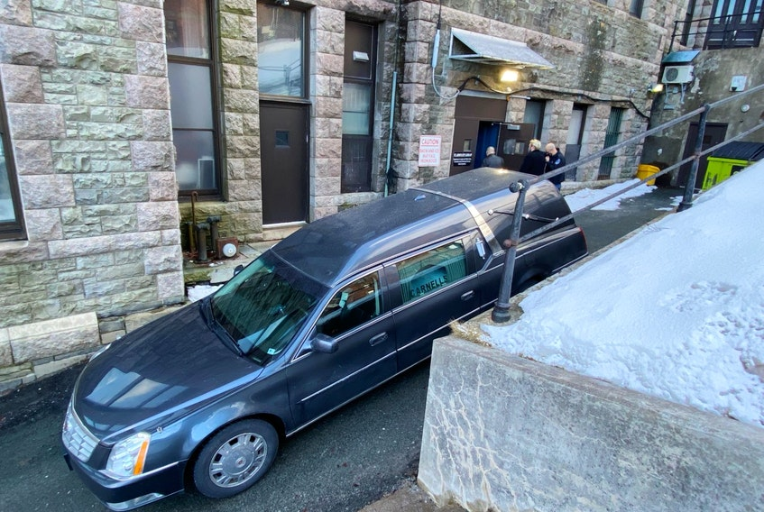 A hearse is parked in the laneway next to the lock-up located in the building housing the Newfoundland and Labrador Supreme Couty in St. John's — Keith Gosse/The Telegram.