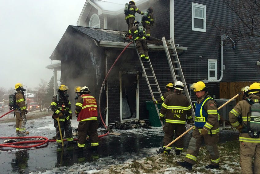 Firefighter's from various stations of the St. John's Regional Fire Department battled a house fire in nasty weather conditions in the Shea Heights area of St. John's today. Joe Gibbons/The Telegram