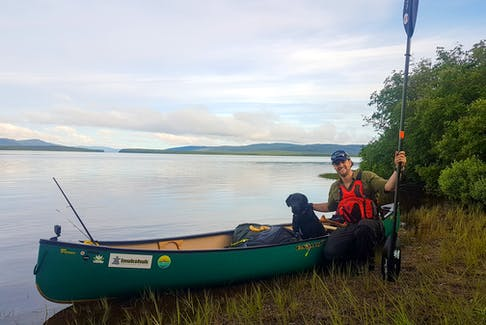 """""""Newfoundland Explorer"""" Justin Barbour and his trusty sidekick Saku completed a long journey from the Long Range Mountains in Labrador and wound up in Cape Broyle. He has chronicled that journey into a new book titled """"Man and Dog"""" that was released on Oct. 5. — Submitted"""