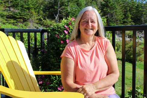 Mary Louise Snow loves her home province of Newfoundland. That love brought her back here to pursue a career, start a family and build a life and a home in C.B.S. She sits on her deck recently enjoying the grounds and admiring her garden while doing an interview for this 20 Questions feature.