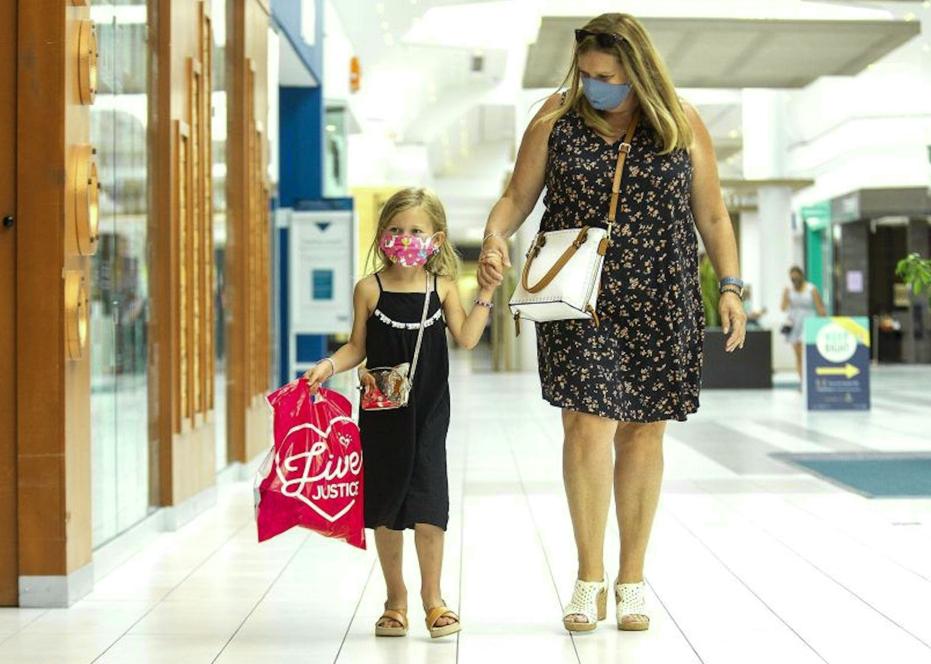 In this file photo from earlier this month, a woman and her daughter wear facemasks as they stroll through in a London, Ont., shopping mall. Beginning next Monday, Newfoundland and Labrador will join many other jurisdictions across Canada in making non-medical facemasks mandatory in public spaces.