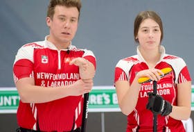 Newfoundland and Labrador champions Greg Smith and Mckenzie Mitchell discuss their next shot during a game at the Canadian mixed doubles championships in Calgary.