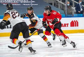 """Team Canada is said to be """"somewhat optimistic"""" Alex Newhook (15), shown skating against Germany in a preliminary-round game, will be able to play in today's world junior hockey semifinal game versus Russia in Edmonton."""