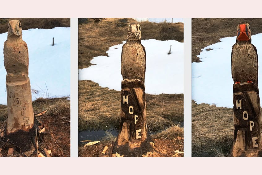 """Progress is made on a carving of a puffin, emblazoned with the word """"Hope,"""" earlier this month along a trail near Renews. — Contributed"""