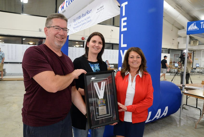 Carol Tower is the winner of the design contest for the 2019 Tely 10 finisher medal. — Telegram photo