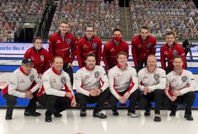 Members of the two St. John's-based teams competing at this year's Brier pose for a photo before their head-to-head matchup Wednesday night in Calgary. In the front row (left to right) are members of Team Canada: coach Jules Owchar,  lead Geoff Walker, second Brett Gallant, alternate Ryan McNeil Lamswood, third Mark Nichols and skip Brad Gushue. In the back row (left to right) are members of Newfoundland and Labrador's entry: coach Leslie Anne Walsh, lead Evan McDonah, second Alex McDonah, alternate Adam Boland, third Greg Blyde and skip Greg Smith. Team Canada won 11-3.