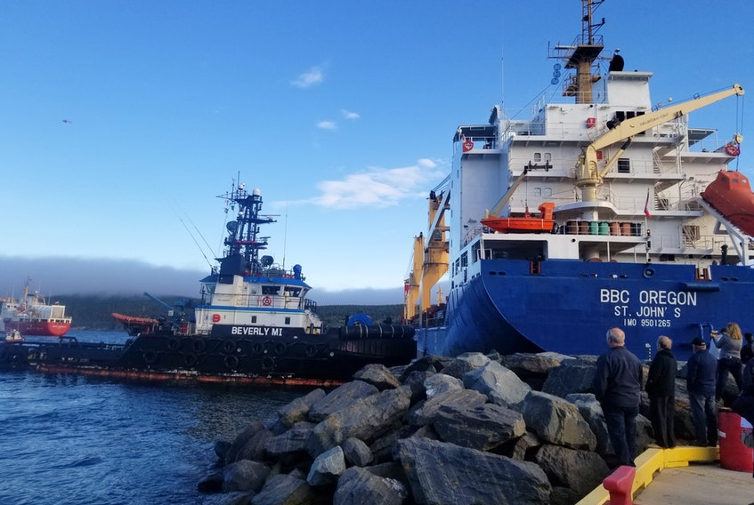 A tug pulls a ship off the rocks in Bull Arm, N.L. this past June. The tug business in Atlantic Canada is very competitive. - Coast Guard photo