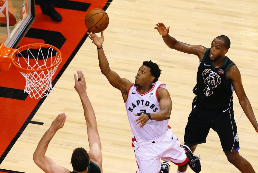 TorontoRaptorsguard Kyle Lowry goes up to make a basket as Milwaukee Bucks center Brook Lopez (11) and Bucks forward Khris Middleton look on during game six of the Eastern conference finals. - John E. Sokolowski/USA TODAY Sports