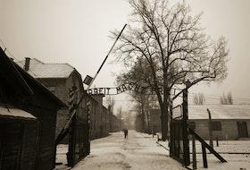 Arbeit Mach Frei (Work liberates) sing at the German Second World War prisoner camp Aushwitz, Poland