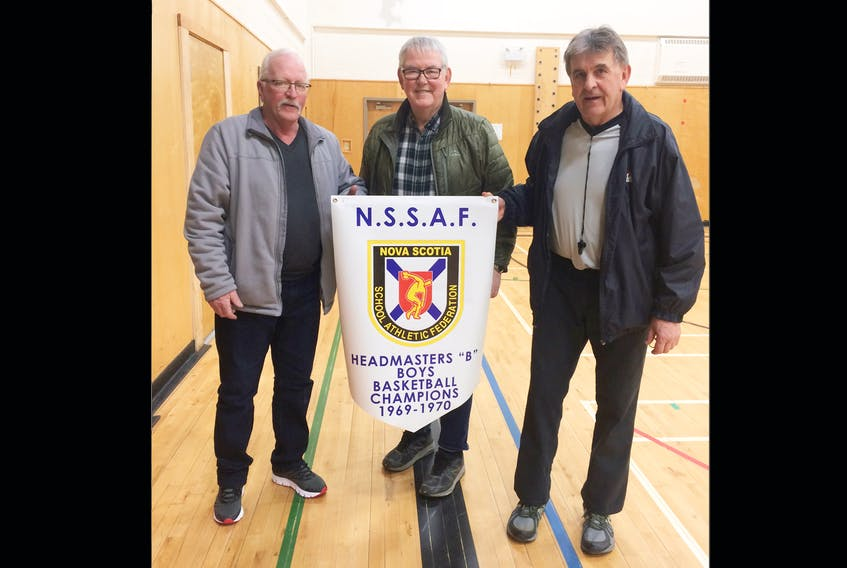 Wayne Smith, Alex Ryan and Doug Ryan played on the 1969-70 Inverness Rebels team that won a provincial high school basketball title.  The team's original championship banner was lost when their school was torn down. A new banner was presented to the team during a recent ceremony.