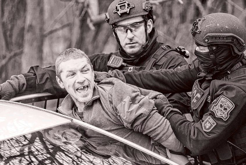 A man is taken into custody by tactical members of the Halifax Regional Police, after barricading himself in his home on Evans Avenue in Fairview Tuesday. It was reported that a man had assaulted a woman and a male youth and that all parties are known to each other. TIM KROCHAK • THE CHRONICLE HERALD