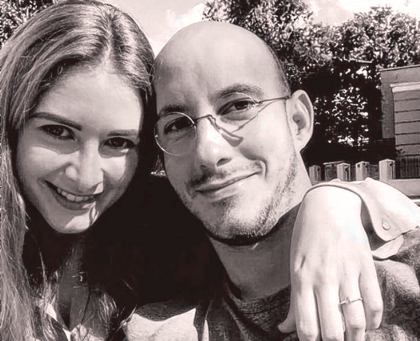 David Cloux is shown in a 2017 photo with his fiancé.