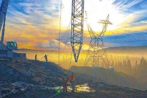 Workers install a tower during construction of the Labrador-Island link.