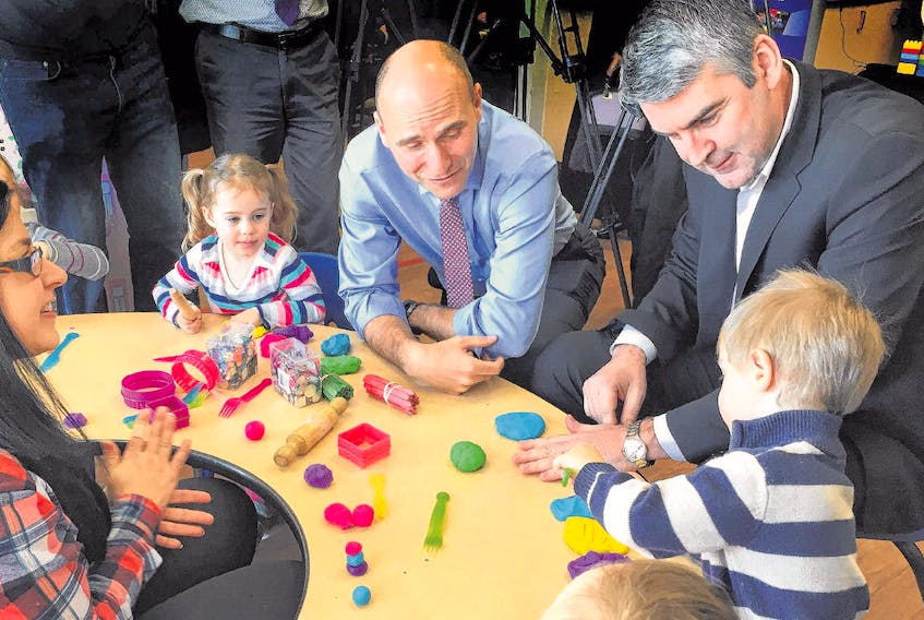 Premier Stephen McNeil and Jean-Yves Duclos, federal minister of families, children and social development, join children at St. Joseph's Children Centre in Bedford and their teacher, April Burt, before a daycare funding announcement Wednesday.