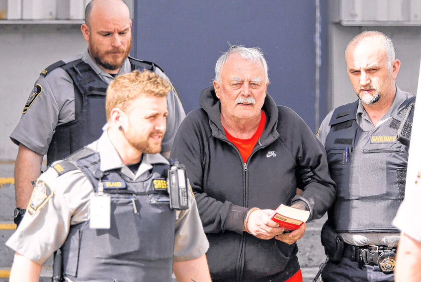 Joseph Noel Landry, 68, is led out of Dartmouth provincial court following a court appearance Wednesday. Landry is facing a second-degree murder charge in the death of Darren Clyde Reid in a Portland Street apartment Monday night.