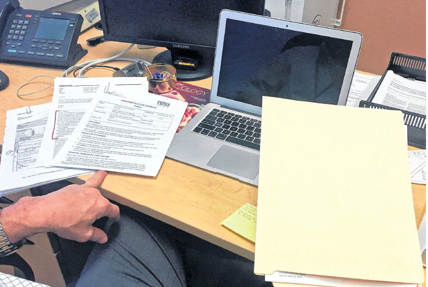 Orthopedic surgeon Michael Gross holds a patient's file in his office at the Halifax Infirmary. Gross isn't happy that the provincial government is suddenly enforcing a ban on hospital-based doctors using electronic medical record systems. JOHN MCPHEE • THE CHRONICLE HERALD