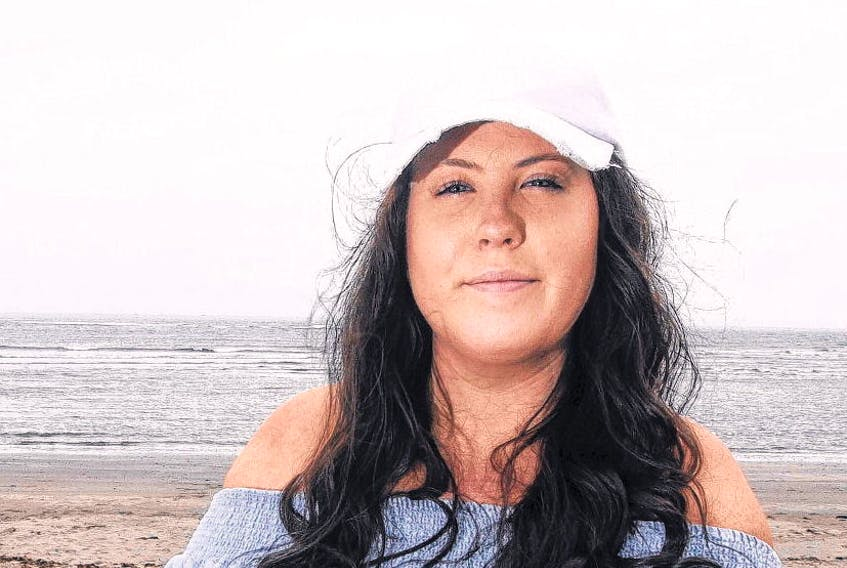 Erin Hines, 24, loves Rainbow Haven Beach and she's going to visit as many times as she's able to. In January she was diagnosed with amyotrophic lateral sclerosis (ALS) or Lou Gehrig Disease.  ERIC WYNNE•THE CHRONICLE HERALD