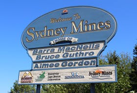 The first of two signs welcoming visitors to Sydney Mines near Highway 125 now proudly displays the name of gold medal winning Special Olympic athlete Aimee Gordon.