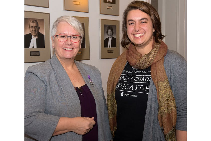 Transportation Minister Paula Biggar speaks with Hannah Gehrels, representing the PEERS Alliance, after an announcement Friday of new gender choice options on driver's licences.